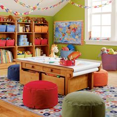 playroom. colors, shelves, table with drawers and paper roll, wood floor and cute rug. What not to love!!!