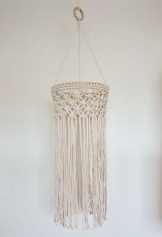 This macrame chandelier measures 35 inches tall from hanging ring to bottom. Chandelier pieces measures 21 inches tall and 9 1/2 inches wide. This chandelier does not come with a light fixture.