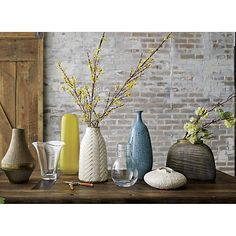 Shop Adra White Chevron Vase.  Bright white glaze brings deeply etched chevron pattern into crisp focus, pairing bold pattern to colorful bouquets.
