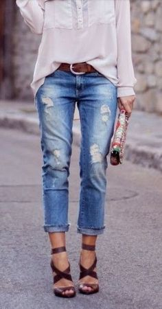 Street style | Shredded denim, loose blouse and strapped heels