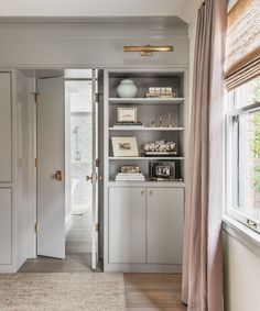 Custom built ins Master Suite Bathroom, Ranch House Remodel, Bedroom Photography, Small Galley Kitchens, Tudor Style Homes, Modern Sconces, Upstairs Bedroom, Brown Interior, Formal Living Rooms
