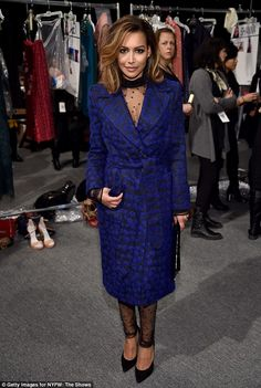 Lacy lady! Naya Rivera took the plunge in a black-and-blue coat that showed off her see-through top and sheer leggings