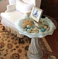 Convert a bird bath into a curio display table for your seashell collection and other beach treasures.
