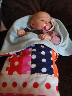 Baby snuggle bag. Not a tutorial, but a good idea. Maybe just sew soft minky fabric to a pillowcase for a baby sleeping bag!