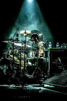 The Rev where he belongs, behind a drum set