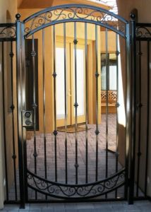 Arched 8' tall courtyard entry gate & panels.