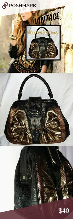 "Vintage Black Tooled Style Metallic Accent Bag Unique Vintage Black Flower & Vine  Tooled Style Handbag with Gold & Bronze Metallic Details & Brass Hardware. Frame Top with small inside snap closure with small flap snap closure over that. Black cloth interior with one zippered side pocket. Excellent vintage condition!  11"" across - 9"" high - 4"" deep & tooled handle is 11 & 1/4"" of an inch long OOAK VINTAGE! Bags"