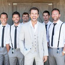 Love the groom's suit and the grooms men's braces!