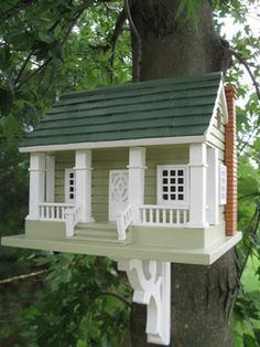 "•Four Pillars in front combined with an intricately carved door and window details    •1.25"" opening will allow wrens, finches, chickadees and nuthatches to nest   •Constructed of exterior grade ply-board, poly resin details, pine shingles for the roof and a non-toxic outdoor paint     Dimensions:13""D x 12""W x 13""H"