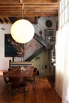 exposed beams + open stairs + over-sized light fixture + a tonne of natural light = beautiful. {Diana Kellogg (architect) via Remodelista}