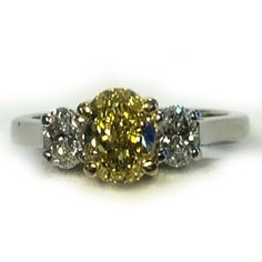 This ring was just acquired by our estate specialist. It is a GIA certified carat oval, natural intense fancy yellow diamond. It is complimented by two surrounding oval diamonds weighing carats, F-G color, clarity. Art Carved, Oval Diamond, Clarity, Compliments, Wedding Bands, Diamonds, Carving, Stud Earrings, Fancy