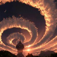 Cloud spiral in the sky. An Iridescent (Rainbow) Cloud in Himalaya.