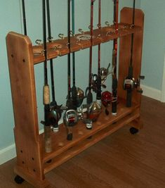 Fishing Rod Holders - Consider Some Of These Great Fishing Tips! Fishing Pole Storage, Fishing Poles, Rod Rack, Wooden Spools, Fishing Tips, Fishing Stuff, Cool Furniture, Making Ideas, Wine Rack