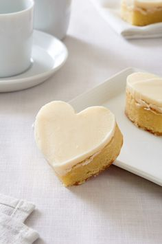 How could anyone not love a heart shaped treat? This recipe for White Chocolate Heart Bars is so delicious you'll have to fend people off! Just Desserts, Delicious Desserts, Dessert Recipes, Yummy Food, Chocolate Hearts, White Chocolate, Yummy Treats, Sweet Treats, Brownie Bar