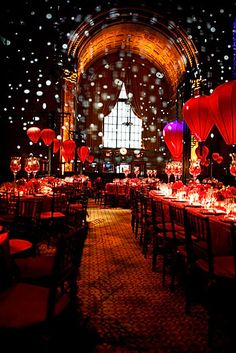 Two other notable design elements are the red shimmer curtain anchoring the stage and oval table tops as an alternative to rectangles.