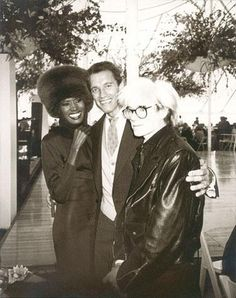 Andy Warhol with Grace Jones and Arnold Schwarzenegger. This was for Arnold's wedding, Grace was Andy's date. He talked about this day in his diary.