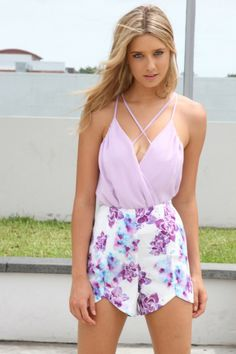 Chic and flattering lilac bodysuit featuring a cross over dual strap design at front and back. Fully lined with overlaid draped front plunging neckline. Wear with high waist jeans and platforms! www.saboskirt.com