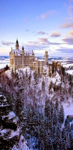 Remote Neuschwanstein Castle is a nineteenth-century Romanesque Revival palace on a rugged hill above the village of Hohenschwangau near Füssen in southwest Bavaria, Munich, Germany