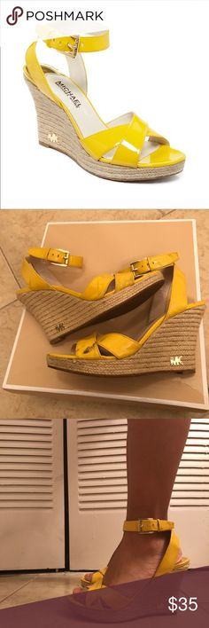 """Michael Kors Yellow Kami Platform Wedge Sandals Important: There is a black stain on each one. Not sure how it happened but I'm a reckless girl 😅🌪 I worn them twice or three times max during summer.  Details below:  Imported. Patent leather upper. Round open-toe platform wedge sandals. 1"""" platform, 3-1/2"""" wedge heel. Man-made sole. Color: yellow Michael Kors Shoes Sandals"""