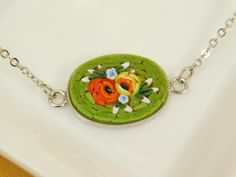 Micro mosaic bracelet - red, yellow flowers - green background by PiccoloMosaico on Etsy