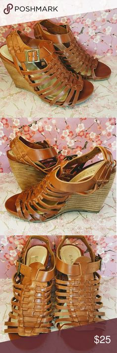 """Bakers brown faux leather gladiator wedge shoes 6 Bakers brown faux leather gladiator wedge shoes 6. Gently used.  Worn only twice.  Wood wedges 4"""" high. Greek gladiator style very in trend.  Stretch side buckle.  Very comfortable street chic look.  Gold sole lining. Bakers Shoes Wedges"""