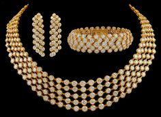 VAN CLEEF & ARPELS Gold Diamond Necklace Suite. France circa 1980s
