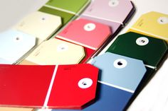 Gift tags from paint chip swatches are upcycled and come in a range of colors, via Etsy.