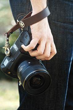 I need this for my camera!! What a stylish but also useful way to keep track of our camera! It's right at our fingertips for capturing events!