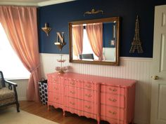 Love the color and finish on the dresser. Pink coral and navy blue nursery with French accents.