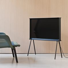 """Serif TV by Ronan and Erwan Bouroullec for Samsung. The Bouroullec brothers' television features a case that flares out into a base at the bottom and a shelf at the top. The resulting form resembles a capital """"I"""" in a serif font when viewed from the side. Minimal Design, Modern Design, Tv Furniture, London Design Festival, Home Entertainment, Home And Living, Interior Architecture, Interior Design, Design Inspiration"""