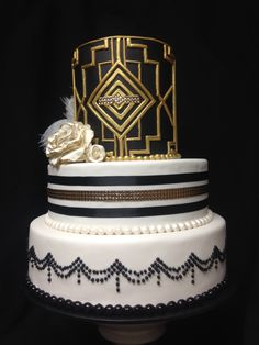 Great Gatsby cake black white and gold and feather details