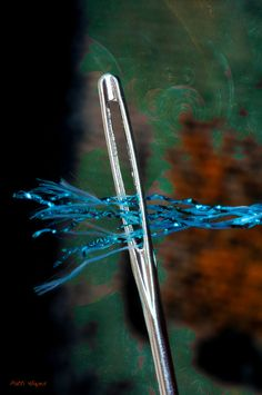 Sewing needle thread close up macro photography
