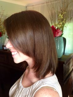 Dark brown color on front layered women's hair cut