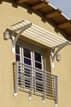 You know this family has some children in the home with the steel railing right outside the window. The matching awning would allow for some decorations on the exterior should they choose.