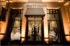 like the up lighting and the formal b & w striped awning.. Another possibility for bridal store front!