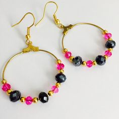 A personal favourite from my Etsy shop https://www.etsy.com/uk/listing/280910902/hot-pink-and-black-beaded-hoop