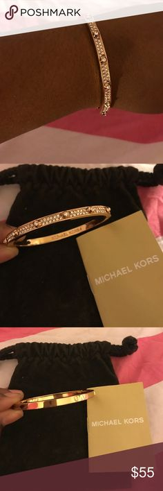 Michael Kors Bracelet Color: Rose Gold...Style 254601 Wear: a couple rhinestones missing from front of bracelet... light scratches on rose gold bangle... Original Retail: $80 Includes: MK jewelry pouch, bracelet, and MK care/instruction booklet. Of course authentic! Lost tag - sorry! Great condition on this one. PRICED TO SELL Michael Kors Jewelry Bracelets