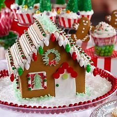 "Easy + adorbs gingerbread house! Love the shredded coconut ""snow."" Click for deets and more Christmas desserts... nom, nom!"