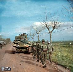 The British Army in Italy 1944 A Sherman tank of 46th Royal Tank Regiment supporting Irish Guardsmen north of Anzio, 25 January 1944.