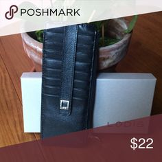 🆕 Lodis Card Protection Wallet Black leather wallet with eight (8) card slots, one (1) ID holder slot, one zipper bill compartment, RFID protection. Comes with box. Please ask if you have questions. Lodis Bags Wallets