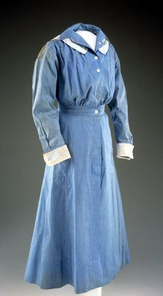 Nurse's Dress c.1919  cotton  Worn by Julia D.S. Snow (Greenfield, Mass.).  U.S. involvement in WWI began when Snow was 26 years old.  She seems to have been fascinated by the war - taking photographs of soldiers off to war.  She joined the war effort as one of the 18,000 plus women from the US who served as nurses in the American Red Cross's nursing corps.  Memorial Hall
