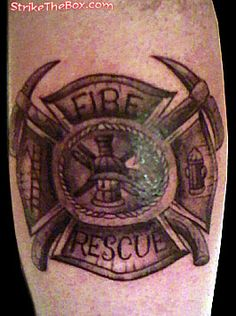 My first tattoo celtic maltese cross with the words fir na for Firefighter tattoos and meanings
