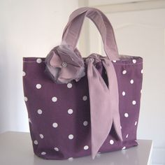 A lovely spotty berry bag This charming bag is perfect for days out It s been lined with a lighter berry fabric with matching handles and middle tie
