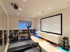 Workout Room with a projector! Now that is awesome! Basement Workout Room, Workout Rooms, Basement Ideas, Crossfit Home Gym, Mother In Law Apartment, Gym Decor, Home Theater Projectors, Decoration, My Dream Home
