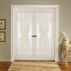 @Overstock.com - Door panels. Tiebacks included. Measured from top of the upper rod pocket to the bottom of the lower rod pocket, exclusive of headers. Rod pocket slides onto curtain rod for installation....http://www.overstock.com/Home-Garden/Lush-Decor-Ivory-72-inch-Sonora-Door-Panels-Set-of-2/6362156/product.html?CID=214117 $33.49