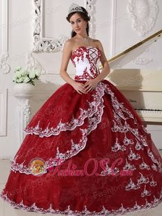 Modest Wine Red and White Quinceanera Dress Strapless  Organza Appliques Ball Gown  http://www.fashionos.com    Dramatic and elegant ball gown!This sparkling quinceanera ball gown features a strapless neckline is accented with contrasting and chic appliques all over the bodice, and the full length tiered bottom skirt with embroidery trimed made this quiceanera dress exclusive!