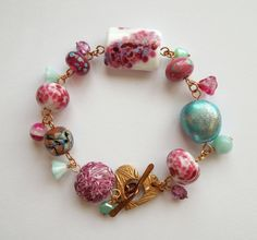 Country Rose bracelet with lampwork by LouiseGoodchild on Etsy