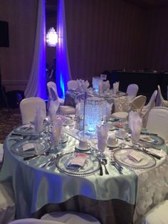 TABLE DECOR  - Black table cloth, silver overlay, vase, gel balls, blue water, tea light candles. For fire tables, red silk or chiffon overlay, red water in vases, clear gel balls. Square mirrors with glitter on the mirrors
