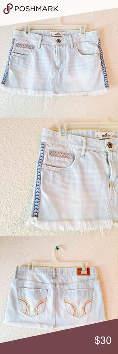 ✨HP✨ Hollister denim fringe cutoff jean mini skirt Incredible skirt from Hollister. Light wash denim jean skirt. Cutoff bottom with a bit of fringe. Embroidered details on sides and pockets. Aztec, tribal vibe that's perfect for summer, festivals and goes with everything. Size 7 / 28. Like new. Hollister Skirts Mini