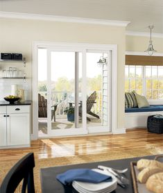 Interior image featuring a Infinity Sliding French Door in Stone White interior finish with White hardware and a Beige sill. White Interior, Doors, Home, Exterior Doors, Sliding French Doors, Windows, Home Remodeling, French Doors, Interior Design